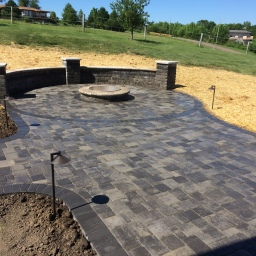 Firepit patio with lighting and walls