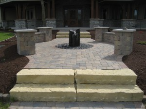 Front entry with limestone steps, sitting area and water feature