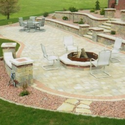 Patio with retaining walls, steps, firepit, seat walls, and pillars
