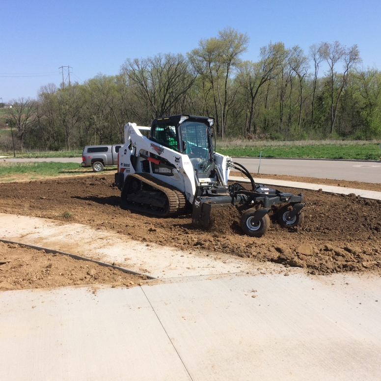 Harley Rake Skid Loader attachment grading a yard