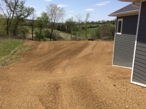Using equipment to prepare lawn for seed